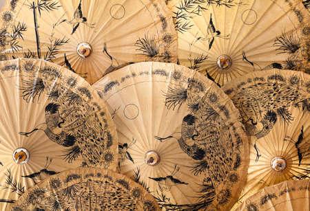 Traditional umbrellas and parasols made of bambus plus handmade paper