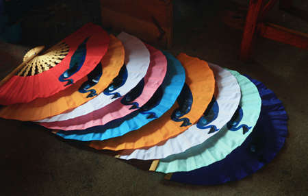 Paper fans in many colors Stock Photo - 6767594