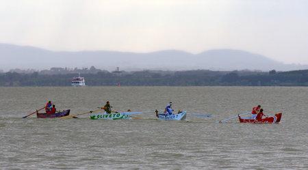 palio: PASSIGNANO SUL TRASIMENO, IT - JULY 25: Palio delle Barche, local Italian traditional boat race on July 25, 2010 in Passignano sul Trasimeno, IT