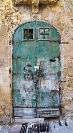 Old green fringed door in Valletta, Malta Stock Photo