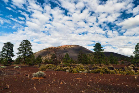 Sunset Crater Volcano National Monument is the slightly tautological name given to an area northeast of Flagstaff containing the results of much igneous activity - several colorful cinder cones formed by extinct volcanoes. Stock Photo