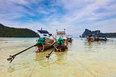 Longboats on Phi Phi island, Thailand photo