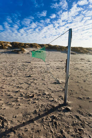 i net: Dunes at the Danish North Sea coast at the beach of Henne with volley net i front Stock Photo