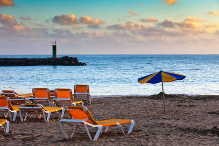 rico: Scenic view of tourist beach of Puerto Rico on island of Gran Canaria. Stock Photo