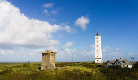 This lighthouse is situated in the most western part of Denmark where stormy weather is quite common Stock Photo
