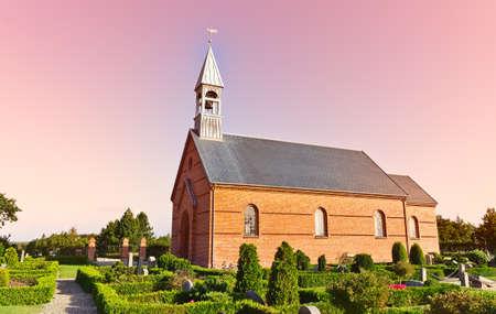 Minimalistic Danish church in Mosevraa on the heather Stock Photo - 10667547