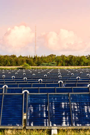 Solar heating plant producing hot water for power and house heating photo
