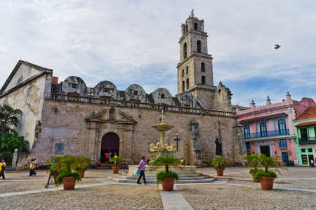 Wide view of an urban scene in Old Havana with a view of typical houses and Church