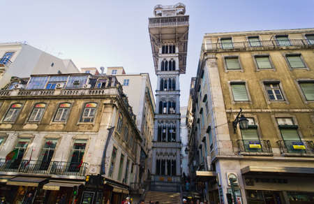 elevador: Santa Justa Elevator in Lisbon, Portugal. Connecting downtown to Bairro Alto Made by the French architect Raoul de Mesnier du Ponsard an apprentice of Gustave Eiffel