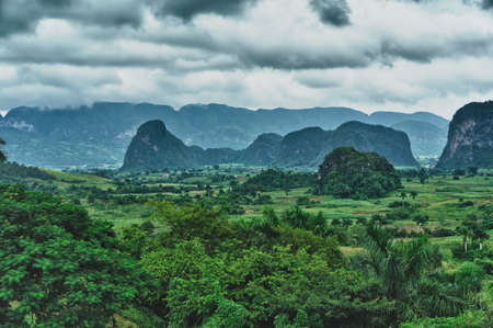 The beautiful Vinales Valley in Cuba. The Vinales Valley has been on UNESCOs World Heritage List since November 1999 as a cultural landscape enriched by traditional farm and village architecture.