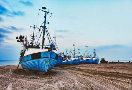 Coastal Fishing boats at the beach of Thorup, Denmark photo
