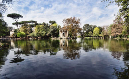 Temple of Esculapio, located at the beautiful park of villa borghese, Rome, Italy  Editorial