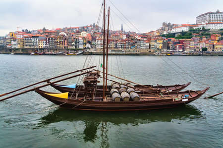 rabelo: View of Porto city at the riverbank  Ribeira quarter  and wine boats  Rabelo   on River Douro Portugal  Stock Photo