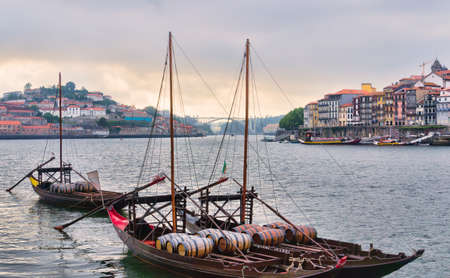 View of Porto city at the riverbank  Ribeira quarter  and wine boats  Rabelo   on River Douro Portugal