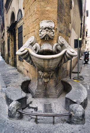 grotesque: Marble street drink water source, Florence, Italy Stock Photo