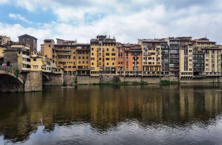 ponte vechio: The Ponte Vecchio is a Medieval bridge over the Arno River, in Florence, Italy, noted for still having shops built along it, as was once common