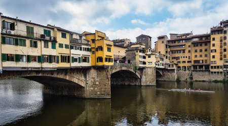 ponte vechio: The Ponte Vecchio is a Medieval bridge over the Arno River, in Firenze, Italy, noted for still having shops built along it, as was once common