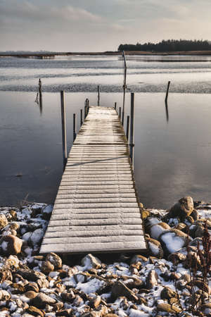 desolation: Pier in frosty air and cold water, Nyborg, Denmark