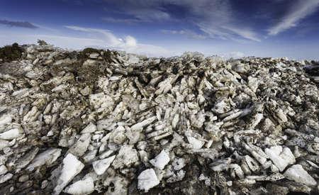 wadden sea: Wadden sea road to the island Mando in wintertime with ice screwings, Denmark Stock Photo