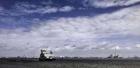 Panorama of Esbjerg oil harbor with the ferry to Fano, Denmark photo