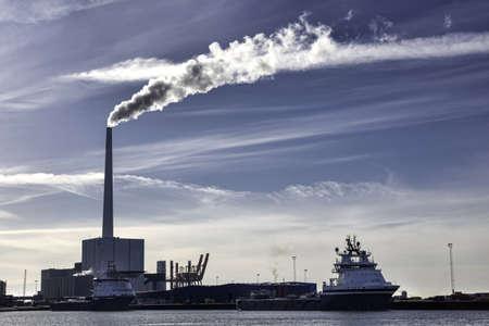 Oil supply ships and power station in Esbjerg harbor, Denmark photo