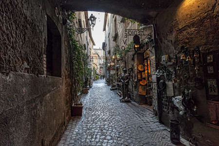 Orvieto in Umbria, Italy, narrow street with small shops