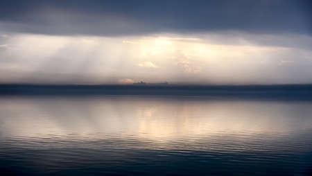 Foggy evening in Passignano at Lake Trasimeno, Umbria, Italy photo