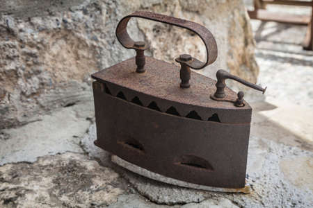 woodfired: Classic old and rusty woodfired Iron for ironing
