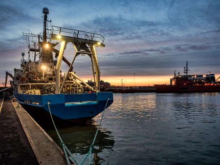 esbjerg: Trawler in Esbjerg oil harbor in Denmark Stock Photo