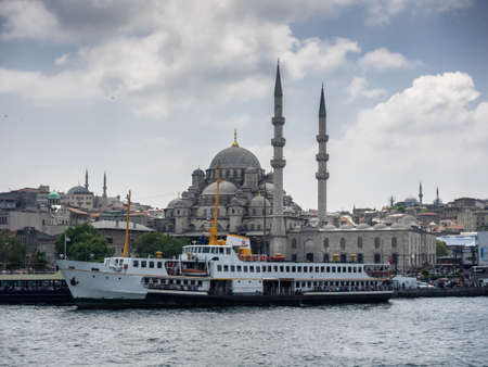 eminonu: New Mosque and harbor with ships in Istanbul, Turkey