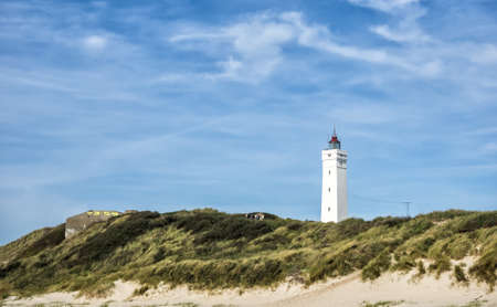 Lighthouse in Blaavand at the stormy Dansih North Sea coast Stock Photo