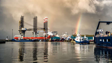 Jack up rig with six legs in Esbjerg oil harbor, Denmark photo