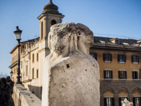 two faced: Quattro Capi (four heads) two marble pillars the Ponte Fabricio Bridge in Rome, Italy Stock Photo