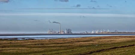 Panorama of Esbjerg wind turbine and oil harbor, Denmark photo
