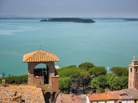 isola: Trasimeno lake with Isola Maggiore seen from the castle in Passignano, Umbria Italy Editorial