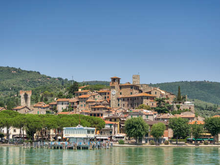 small country town: Passignano seen from the Trasimeno lakeside in Umbria, Italy