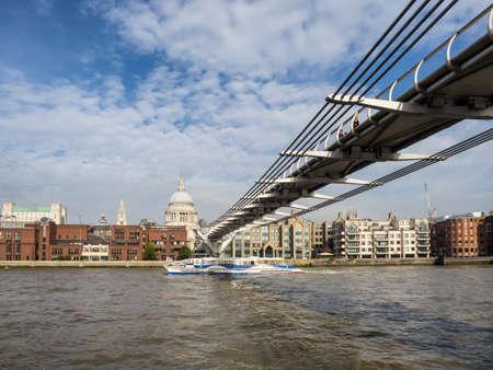 footbridges: London skyline with Millenium bridge seen from Thames