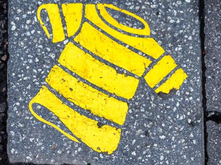 yellow shirt: Yellow shirt sign on the asphalt Stock Photo