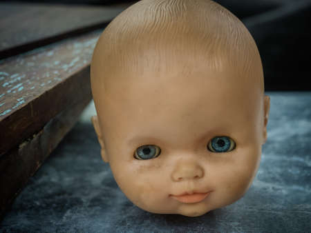 Antique doll head staring, without body