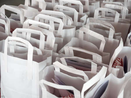 paper bags: White paper bags in straight rows Stock Photo