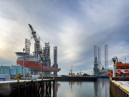 esbjerg: Jack up rig with six legs in Esbjerg oil harbor, Denmark Editorial