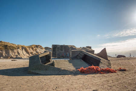 world war 2: Bunker on a Danish beach. Fortification by the North Sea coast from world war 2