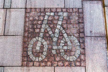 bycicle: Bycicle street sign made of cobblestones