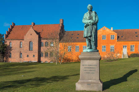 hans: Hans Christian Andersen statue near the river in Odense, Dernmark