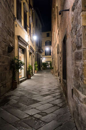 lucca: Small streets at night in Lucca, Italy Stock Photo