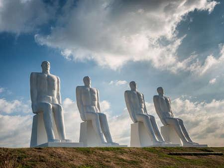 esbjerg: Men at sea colossal statues near Esbjerg harbor, Denmark Stock Photo