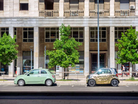 Streets in Milan with two cars, one golden, Italy