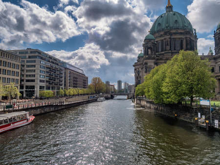 bode: River Spree with tour boats in Berlin Mitte, Germany Stock Photo