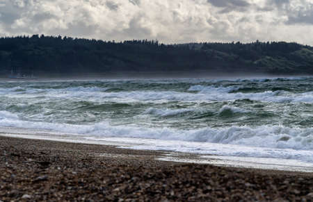 danish: Moving Waves and clouds at Slette beach in Thy, Denmark Stock Photo