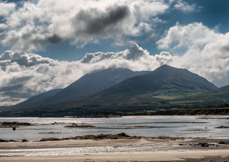 Croagh Patrick in clouds seen from Louisburgh small harbor in Ireland 版權商用圖片